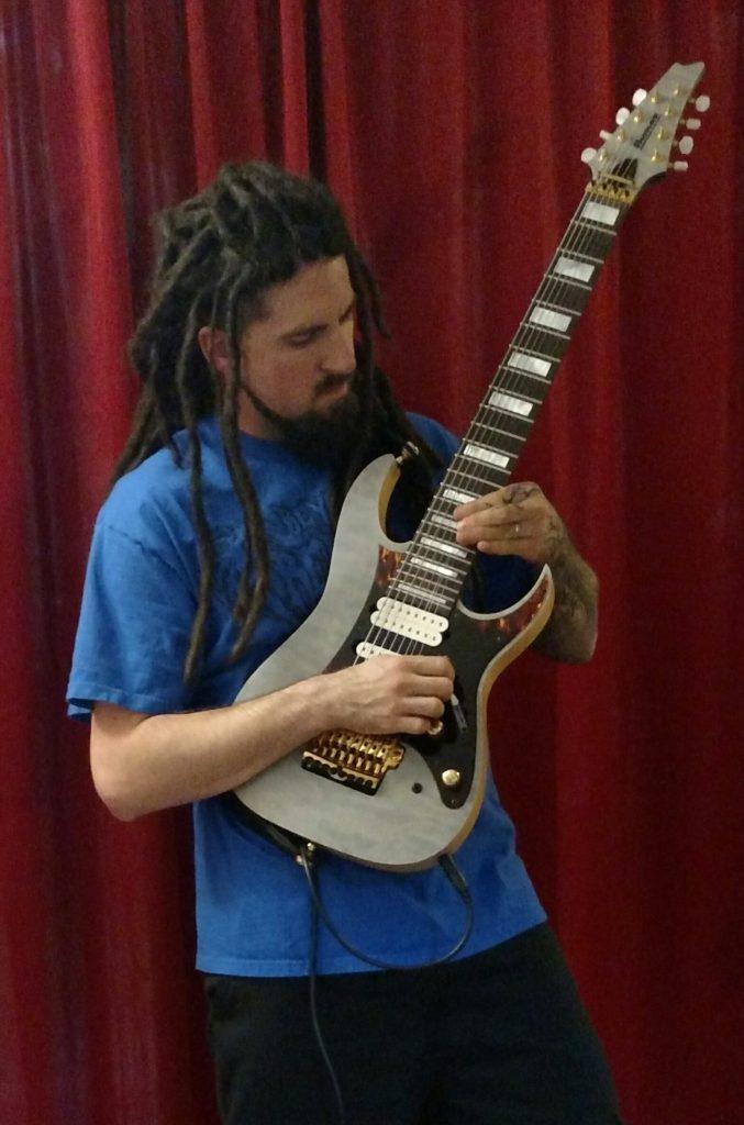 Gray Hinry Playing Guitar